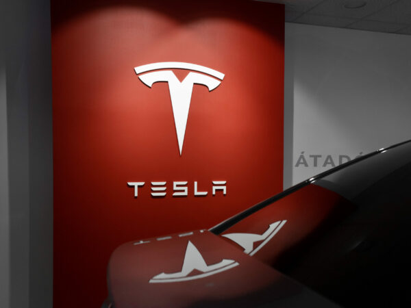 Tesla sign illuminated in a Tesla showroom