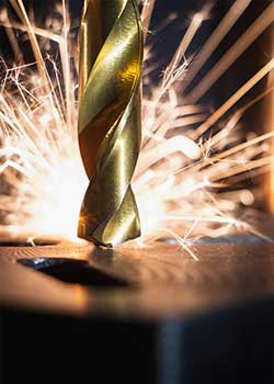 Drill bit sparking as it drills into Iron