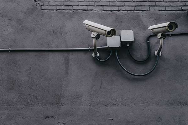 Two security cameras mounted on a wall