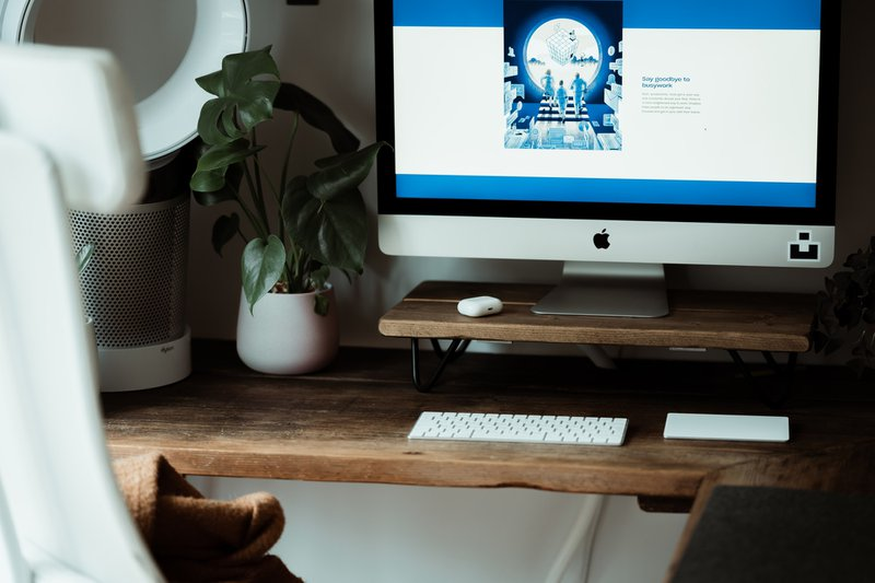 Dropbox stock website on iMac in home office