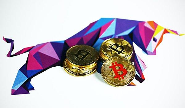 Stacks of Bitcoins with executium's bull logo.