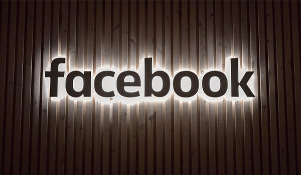 Facebook shares suffer following outage